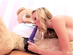 Brett Rossi plays with a tucked bear's strap-on fake penis