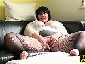 lush uk mature thumbs her pussy in fishnets