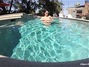 curvaceous Alison swims and milks in the pool