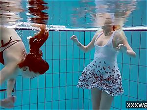 hot Russian women swimming in the pool